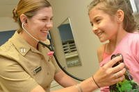 Lt. Allison Wessner, a pediatrician at Naval Hospital Jacksonville, conducts a check-up. (Photo: U.S. Navy/Jacob Sippel)