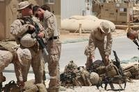 U.S. Marines attached to Task Force Al Asad with 1st Battalion, 7th Marine Regiment, Special Purpose Marine Air-Ground Task Force-Crisis Response-Central Command, prepare to assume their security positions while at Al Asad Air Base, Iraq, July 5, 2017. (U.S. Marine Corps photo/Dave Williams)