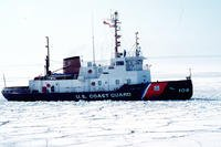 Coast Guard Cutter Biscayne Bay (WTGB 104) breaks ice in the Straits of Mackinaw on the Great Lakes, April 6, 1992. (U.S. Coast Guard photo/CAROLYN CIHELKA)