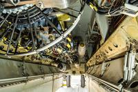 A B-52 bomber sits on a flightline with munitions loaded on a newly installed conventional rotary launcher in its bomb bay, at Al Udeid Air Base, Qatar, on Nov. 17, 2017. The CRL will allow the B-52 to carry more smart bombs.