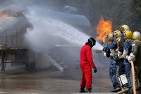Sailors from various commands combat a simulated flight deck fire during a flight deck firefighting course at the Center for Naval Aviation Technical Training Unit Whidbey Island at Naval Air Station Whidbey Island, May 18, 2010. (U.S. Navy photo/Nardel Gervacio)