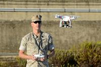 Master Sgt. Chad E. McMeen uses a commercial-grade Quadcopter to capture aerial video footage of the USNS William R. Button on the pier in Rota, Spain, in 2015. (U.S. Army photo by Visual Information Specialist Jason Johnston)