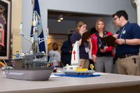 Judges examine an entry during the Brick-by-Brick Lego Shipbuilding Competition at the Hampton Roads Naval Museum. (Defense Department)