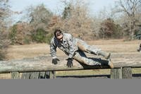 Air Force Tech. Sgt. Jennifer Brown, an education and training specialist with the Texas Air National Guard's 273rd Cyber Operations Squadron, jumps over an obstacle during the 2018 Best Warrior Competition near Bastrop, Texas, March 1, 2018. (Texas Air National Guard/Agustin Salazar)