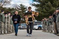Members of the 436th Security Forces Squadron render a final salute to retired Military Working Dog Rico. (U.S. Air Force/Roland Balik)