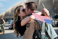 Capts. Laura and Bryan Watson, 4th Force Support Squadron operations officer and 336th Fighter Squadron pilot, kiss during a deployment homecoming, April 11, 2018, at Seymour Johnson Air Force Base, North Carolina. (U.S. Air Force photo/Shawna L. Keyes)