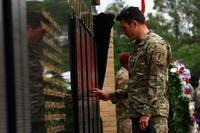 A Special Forces Soldier touches the U.S. Army Special Operations Command Memorial Wall, during the Fallen Warrior Memorial Ceremony, May 24, 2018 at Fort Bragg. (U.S. Army photo/Dillon Heyliger)