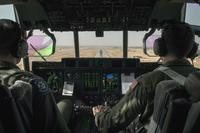 Two U.S. Air Force pilots prepare to land a C-130J Super Hercules Sept. 9, 2015, at Diyarbakir Air Base, Turkey. (U.S. Air Force/Airman 1st Class Cory W. Bush)