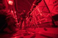 U.S. Air Force Senior Airman Jeremy Kosick, 816th Expeditionary Airlift Squadron instructor loadmaster, checks the cargo straps covering container delivery system bundles on a C-17 Globemaster III before a airdrop over Afghanistan, May 10, 2018. (U.S. Air Force/Staff Sgt. Keith James)
