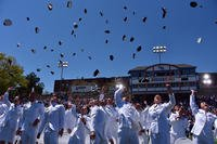 The new ensigns in the Coast Guard toss their hats in the air during the 136th Coast Guard Academy commencement exercise in New London, Conn., May 17, 2017. (Coast Guard photo/Patrick Kelley)