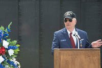 Retired Air Force Capt. Johnny Blye speaks at The Wall That Heals in Camden, S.C., May 5, 2018. Blye thanked the witnesses to the presentation of his Distinguished Flying Cross and urged Americans to remember the sacrifices of Vietnam veterans. (U.S. Air Force photo/Benjamin Ingold)