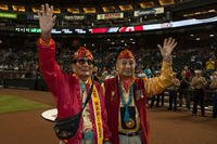 Samuel Tom Holiday, left and Peter McDonald, U.S. Marine Corps Navajo Code Talkers, wave to the crowd before an Arizona Diamondbacks vs. Los Angeles Dodgers baseball game at Chase Field, Phoenix, Sept. 11, 2015, as part of Marine Week Phoenix. (U.S. Marine Corps photo/Samantha K. Draughon)