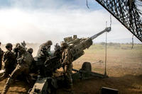 Army soldiers assigned to 25th Division Artillery prepare to fire a 155mm artillery round from an M777 howitzer, in support of Operation Lightning Strike on Pohakuloa Training Area, Hawaii, May 16, 2018. (US Army photo/Ian Morales)