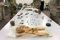 Artifacts recovered from the 2018 Colony glacier recovery mission are displayed on Joint Base Elmendorf-Richardson, Alaska. The mission recovers both human remains and personal items from a 1952 Air Force crash in which 52 U.S. troops perished. (Military.com/Amy Bushatz)