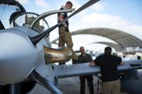 Contractors from the Sierra Nevada Corporation (SNC) perform a post-flight brief for an A-29 Super Tucano, April 24, 2018, at Moody Air Force Base, Ga. (U.S. Air Force/Airman 1st Class Erick Requadt)