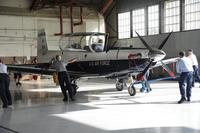 Maintenance personnel roll a T-6 Texan II into a hangar July 9, 2014, at Joint Base San Antonio-Randolph. (U.S. Air Force/A1C Stormy D. Archer)