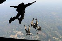 Navy SEALs jump from the ramp of a C-17 Globemaster (U. S. Air Force/Brian Ferguson)