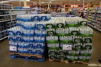 Pallets of Freedom's Choice bottled water stand at the Fort Belvoir, Virginia commissary. (Defense Commissary Agency/Kevin Robinson)
