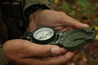 A Marine reads a compass during a land navigation training event in 2013. Several officers could lose their commissions after being accused of cheating on a land nav event while attending The Basic School. (Lance Cpl. Justin Rodriguez/Marine Corps)