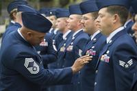 Chief Master Sgt. Gerard Crump, 85th Engineering Installation Squadron, inspects the uniform of Staff Sgt. Bryant Horton, 85th EIS, during a squadron open ranks inspection Nov. 25, 2013. (U.S. Air Force/Adam Bond)