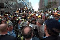 The president greets firefighters, police and rescue personnel, Sept. 14, 2001, while touring the site of the World Trade Center terrorist attack in New York. (Photo by Eric Draper, Courtesy of the George W. Bush Presidential Library)