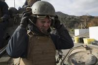 LCpl. Cole Taylor, 19, from San Diego, Calif. puts on his combat vehicle communication helmet aboard Camp Pendleton Jan. 25, 2018. (U.S. Marine Corps/Lance Cpl. Lukas Kalinauskas)