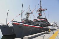 Mine countermeasures ships USS Sentry (MCM 3) and USS Dextrous (MCM 13) are moored pierside at Naval Support Activity Bahrain as a back drop to Commander, Naval Surface Squadron (CNSS) 5's commissioning ceremony. (U.S. Navy/Mass Communication Specialist 2nd Class Victoria Kinney)