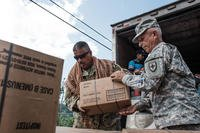 Members of the National Guard load pick-ups with food and boxes of water. (National Guard/Eduardo Martinez)