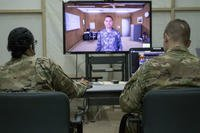 U.S. Army Master Sgt. Breyda Pereyra, left, the noncommissioned officer in charge of U.S. Army Central's G37 office, and U.S. Army Capt. Jordan Smith, the outgoing officer in charge of the U.S. Army Central Readiness Training Center, speak with a virtual soldier avatar in an Intelligence and Electronic Warfare Tactical Proficiency Trainer program designed to simulate a conversation with a soldier having suicidal thoughts, Camp Buehring, Kuwait, Sept. 12, 2018. (U.S. Army photo/Adam Parent)