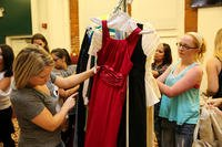 Military spouses look through racks of donated dresses to choose a dress for the Marine Corps birthday ball during Operation Ball Gown, Sept. 8, 2014. (U.S. Marine Corps photo/Sarah Cherry)