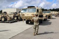 3rd Expeditionary Sustainment Command Soldier lines up vehicle in preparation for Hurricane Florence at Fort Bragg, North Carolina, September 12, 2018. (U.S. Army/Staff Sgt. Terrance Payton)