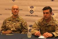 Air Force Maj. Charles Hodges, left, and Master Sgt. Derek Anderson, both of the 320th Special Tactics Squadron, out of the 353rd Special Operations Group, based in Kadena, Japan, discuss their contributions to the rescue of a Thai soccer team from a cave system during the Air Force Association conference in September 2018. Hope Hodge Seck/Military.com