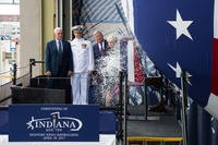 Ship's Sponsor Diane Donald christens the Virginia-class submarine Indiana (SSN 789), witnessed by (from left) Vice President Mike Pence, Indiana's Commanding Officer, Cdr. Jesse Zimbauer and Newport News Shipbuilding President Matt Mulherin, April 29, 2017. (U.S. Navy photo courtesy Huntington Ingalls Industries/Ashley Major)