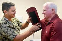 Hospitalman Addis Murray takes retired senior chief Dennis Bennett's blood pressure at Naval Hospital Jacksonville's Family Medicine clinic. (U.S. Navy/Jacob Sippel)