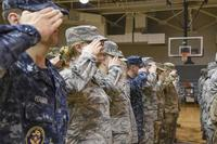 Sailors, Airmen, and Soldiers salute in formation during the closing ceremony June 5, 2018, of an Innovative Readiness Training in Thomasville, Alabama. (U.S. Air National Guard/Airman Cameron Lewis)
