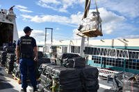 A pallet of interdicted cocaine is offloaded from the Coast Guard Cutter James (WMSL-754) by crane Nov. 15, 2018 in Port Everglades, Florida. (U.S. Coast Guard photo/Brandon Murray)