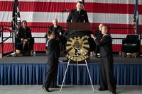 Squadron plank owners reveal the new logo for Fleet Logistics Multi-Mission Squadron 30 Titans (VRM-30) at the establishment ceremony as Cmdr. Trevor F. Hermann, Commanding officer, VRM-30, looks on, December 14, 2018. (U.S. Navy/Mass Communication Specialist 2nd Class Chelsea D. Meiller)