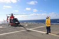 An MH-65 Dolphin helicopter prepares to take off from the Coast Guard Cutter Hamilton's flight deck, Nov. 11, 2018. (U.S. Coast Guard photo/Kiana Kekoa)