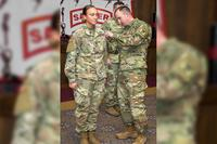 Sergeant Hailey Falk, combat engineer with 39th Brigade Engineer Battalion, 2nd Brigade Combat Team, 101st Airborne Division, receives her Sapper tab from Capt. Timothy Smith during the Sapper Leader Course graduation ceremony Dec. 7, 2018, at Fort Leonard Wood, Missouri. (Photo: U.S. Army)