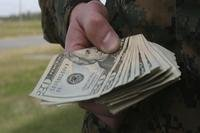Soldier holding cash
