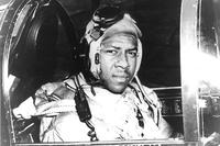Ensign Jesse L. Brown, USN In the cockpit of an F4U-4 Corsair fighter, circa 1940. He was the first African-American Naval Aviator to see combat. Brown was shot down over North Korea. (National Archives)