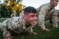 Pfc. Anthony Muratore, scout sniper screener candidate, conducts a max set of push-ups after completing a 1.5 mile ruck run at Marine Corps Base Camp Lejeune, N.C., Oct. 20, 2015.  (U.S. Marine Corps/Cpl. Kirstin Merrimarahajara)