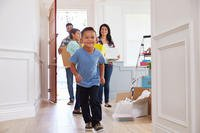 A family with little boy moving into new home