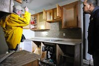 A home inspector examines a kitchen