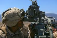A Marine assigned to Company A, 1st Battalion, 11th Marine Regiment, 1st Marine Division, prepares an M777 howitzer to fire, at Marine Corps Base Camp Pendleton, June 17, 2015. (Marine Corps/ Cpl. William Perkins)