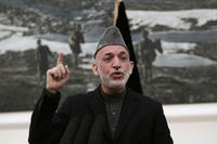 Karzai speaks at a news conference.