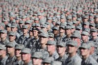 Soldiers and airmen from the Arizona National Guard assemble in a mass formation during the Arizona National Guard Muster in 2014. U.S. Army National Guard Photo by Staff Sgt. Brian A. Barbour