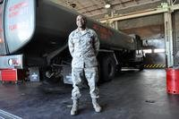Capt. George Okorodudu, 60th Logistics Readiness Squadron fuels flight commander, stands in front a fuel tanker at Travis Air Force Base, Calif. (U.S. Air Force photo by Airman 1st Class Madelyn Ottem)