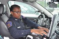 Officer using squad car computer.
