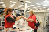 Bagging items at checkout.